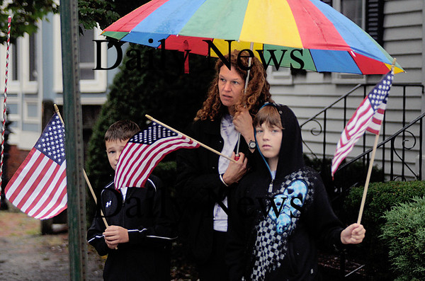 Newburyport: Nancy Dunn of Newburyport came out to show her respects with her sons, Alex, 10 and Cameron, 9, as the motorcade for  Sgt. Jordan Shay leaves on High Street  in Newburyport Saturday morning. Jim Vaiknoras/Staff photo