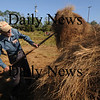 "Newbury: Dick Cunningham stacks hay during a Trails and Sails demonstration ""Making Hay in the Sunshine"" along the Plum Island Turnpike Saturday. Jim Vaiknoras/Staff photo"