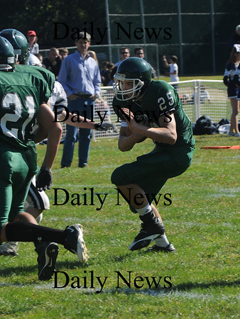 West Newbury: Pentucket's Matt Barrymakes a cut inside to score on a short run against Hamilton-Wenham Saturday . Jim Vaiknoras/Staff photo