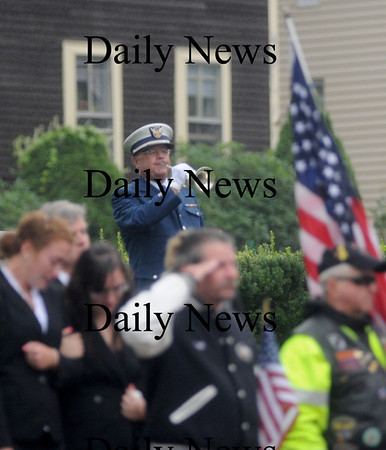 Amesbury:Taps is played at the funeral of  Sgt. Jordan Shay at St Joseph's Church in Amesbury  Saturday morning. Jim Vaiknoras/Staff photo