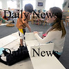 Newburyport: Zach Britz, 5, helps his teacher Becky Adams assemble a shelf unit in the Kinderhaus at the Charter Valley School in Newburyport Friday. Jim Vaiknoras/Staff photo
