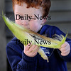 Newbury: Dougie Aylward, 3, tries his hand at corn husking at the annual Harvest Festival at the Spencer-Pierce Little Farm in Newbury. Jim Vaiknoras/Staff photo