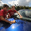 Amesbury: Amesbury high school students Cassie Harding and Ashley Godjikian soap up a car during the Amesbury girls soccer team car wash Sunday afternoon at Burger King in Amesbury. Jim Vaiknoras/Staff photo