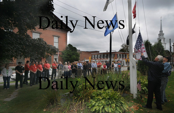 Newburyport: Newburyport Veteran Agent Kevin Hunt raises the Flag of Honor, an American flag containing the names of the victims of the attacks on 9/11/01, at Brown Square Friday morning. Hunt dedicated the flag to the victims and heros of 9/11 as well as Jordan Shay and Derek Hines, local soldiers who were killed in the line of duty. Jim Vaiknoras/Staff photo