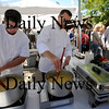 Newburyport:Josh Terry, left and Scott Brandolini of Seaglass Restaurant prepare Fall Harvest Bisque  with ingredients from the Ferry Landing Farm at the Farm to Table Tour at the Newburyport Farmers Market Sunday. Jim Vaiknoras/Staff photo
