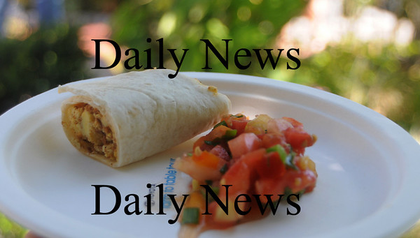 Newburyport: Chorizon Egg Burrito made by Agave with food from the Applecrest Farm at the Farm to Table Tour at the Newburyport Farmers Market Sunday. Jim Vaiknoras/Staff photo