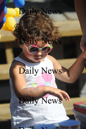 Newburyport: Hazel Mouhizin, 2, looks at her newly painted arm at the Labor Day Festival in Market Square Saturday. Jim Vaiknoras/Staff photo