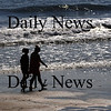 Salisbury:Two women walk along the surfline at low tide Monday morning on Salisbury Beach. Jim Vaiknoras/Staff photo