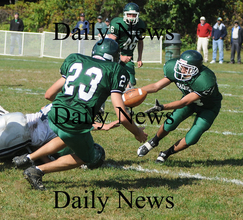 West Newbury: Pentucket's CJ Lataille grabs a fumble against Hamilton-Wenham Saturday . Jim Vaiknoras/Staff photo