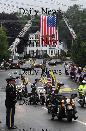 Amesbury:People line School Street as the motorcade for the funeral of Sgt. Jordan Shay passes under an American Flag held by ladder truck from Amesbury and Newburyport in Amesbury Saturday morning. Jim Vaiknoras/Staff photo