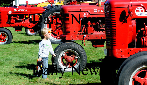 Rowley; Benjamin Chadwick, 4, of Rowley , checks out the antique tractors on display at trhe farmers market on the Rowley Common Sunday morning. Jim Vaiknoras/Staff photo