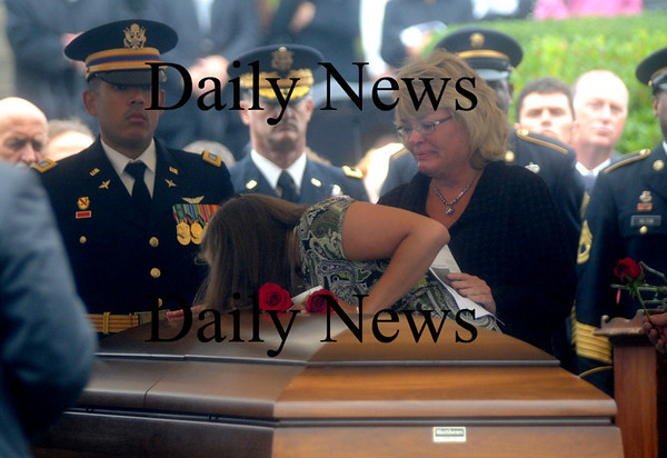 Amesbury:Holly Shay consoles her son's fiance Kelsey Chadonnet as she says her final good bye at  Sgt. Jordan Shay funeral at St Joseph's Church in Amesbury  Saturday morning. Jim Vaiknoras/Staff photo