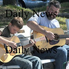 Newburyport: Dan Williams and his son Josh, both of Haverhill, engage in a little strumming and picking in Market Landing Park in Newburyport Sunday afternoon. Jim Vaiknoras/Staff photo