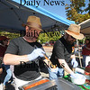 "Amesbury: Jim ""Swampy"" Bateman and Jim Cauldfield of the Amesbury fire dept., donned fedoras for their Indiana Jone inspired Chilipot of Doom entry in the 5th annual Amesbury Firefighter Chili Cook off in the Barking Dog parking lot Sunday. Jim Vaiknoras/Staff photo"