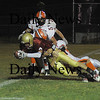 newburyport: Newburyport's Kyle LeBlanc drags a pair of Ipswich defenders over the goal line after catching a pass in the 2nd quarter Friday night. Jim Vaiknoras/ Staff photo