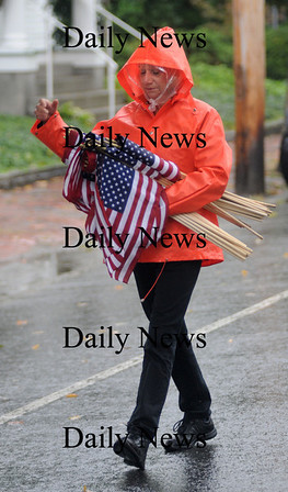Newburyport:Karen Cameron hands out flags on High Street for  the funeral of Sgt. Jordan Shay. Jim Vaiknoras/Staff photo