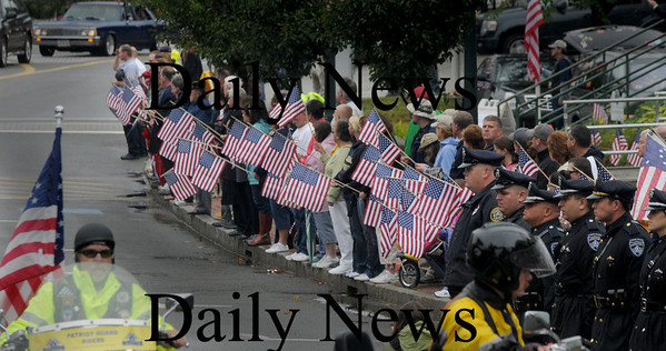 Amesbury:People line School Street  as the motorcade for the funeral of Sgt. Jordan Shay makes it's way to St Joseph's Church in Amesbury  Saturday morning. Jim Vaiknoras/Staff photo