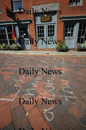 Newburyport: Poems written in chalk on Inn Street in Newburyport. Jim Vaiknoras/Staff photo