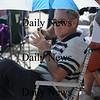 Newburyport: Rich Lombard keeps the sun off him at the Labor Day Festival in Market Square Saturday. Jim Vaiknoras/Staff photo