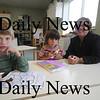 Newburyport: New River Valley Charter School Principal Jean Schultz with Kinderhaus students Django Keyes, 5, and Rachel Laurie. JIm Vaiknoras/Staff photo