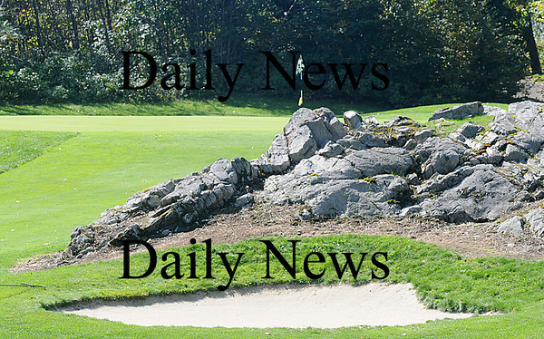 Greenland: A outcropping of rock as well as a sand trap guard the green at the 158 yard par 3 17th at Breakfast Hill Golf Course in Greenland. Jim Vaiknoras/Staff photo