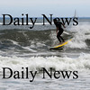 Salisbury: A surfer catches a wave on Salisbury Beach Sunday morning. Jim Vaiknoras/Staff photo