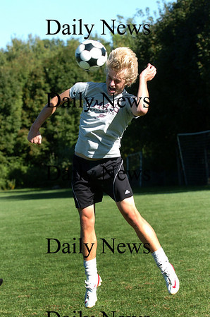 Newburyport: Mark Bajko, senior co-captain of the Newburyport boys soccer team, takes a header during practice on Monday. Photo by Ben Laing/Staff Photo