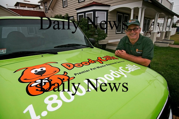 "Newburyport: Joe Gliottone of Plum Island has started a pet waste removal company called ""DoodyCalls"". Photo by Ben Laing/Staff Photo"