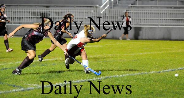 Amesbury: Amesbury's Anna Webber (8) takes a shot while Newburyport's haley Johnson (6) tries to deflect it as the two teams faced off at Landry Stadium Wednesday night. Photo by Ben Laing/Staff Photo