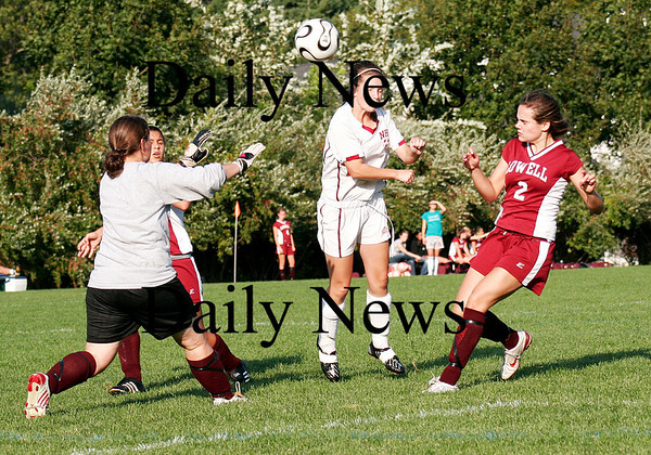 Newburyport: Newburyport's Taylor Summit (14) gave Newburyport a great scoring oppurtunity against Lowell early in Monday's game, as she headed a cross past the goalkeeper. Unfortunately the ball sailed just wide of the post. Photo by Ben Laing/Staff Photo