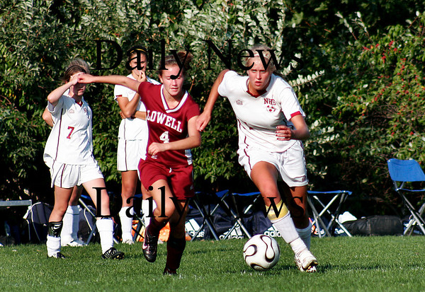 Newburyport: Newburyport's senior co-captain Lindsey Tomasz (1) sprints past a Lowell defender as the two teams met at Cherry Hill on Tuesday.