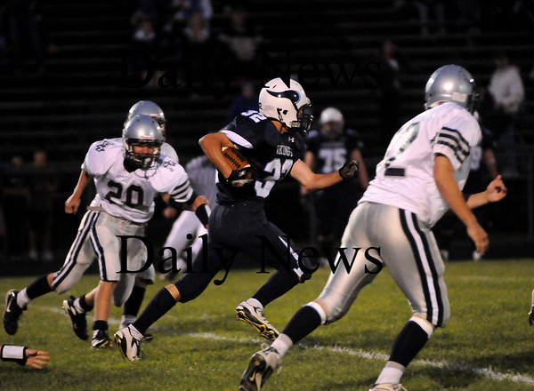 Byfield: Triton running back Matt Pearson (32) bursts through the Hamilton-Wenham defense as the Vikings faced the Generals in Byfield Friday night. Photo by Ben Laing/Staff Photo