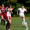 Newburyport: Newburyport's Shawn Crifo (2) dribbles her way through a few Lowell defenders as the two teams played Monday at Cherry Hill. Photo by Ben Laing/Staff Photo