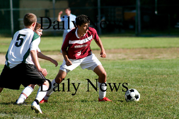 West Newbury: Newburyport midfielder Yazid Eideh (9) looks to control the ball as Pentucket's Joshua Croteau (5) applies pressure. The Clippers defeated their hosts 2-1. Photo by Ben Laing/Staff Photo