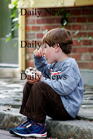 Newburyport: Colby Stebbins, 5, of Newburyport, eats some ice cream while he waits for his mom outside of the England Micro Creamery on Inn Street Tuesday afternoon. Photo by Ben Laing/Staff Photo