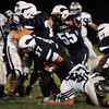 Byfield: Brendan O'Neil (37) powers through the Hamilton-Wenham defense Friday night. Photo by Ben Laing/Staff Photo