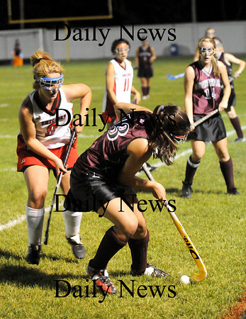 Amesbury: Newburyport's Cassaundra Davis (13) collects a pass from teammate Rachel Notargiacomo (14) while Amesbury's Anna Webber (8) applies pressure. The two rivals faced off Wednesay night at Landry Stadium in Amesbury. Photo by Ben Laing/Staff Photo