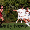 Newburyport: Clipper Caitlin O'Connor (16) gets rid of the ball while being pressured by a Lowell attacker during Monday afternoon's game at Cherry Hill. Photo by Ben Laing/Staff Photo