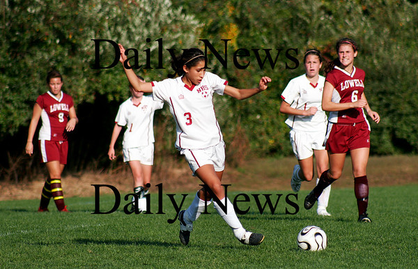 Newburyport: Gabby Martin (3, of Newburyport, picks up a loose ball as the Clippers hosted Lowell at Cherry Hill on Monday. Photo by Ben Laing/Staff Photo