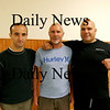 North Hampton: Michael Rosa, center, of North Hampton, will compete Saturday night in a Global Fight League match in Concord, NH. His brother Chucky, right, and sensai Andrew Moores, left, have been training Michael at Atlantic Karate Training Center in North Hampton. Photo by Ben Laing/Staff Photo