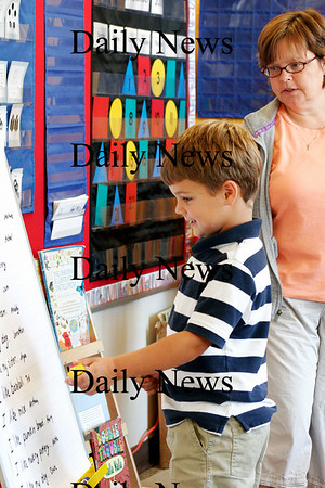 Newburyport: Jonanthan Brown reads sentance about some of his favorite things during Linda Gershuny's kindergarten class at the Brown School Monday morning. Photo by Ben Laing/Staff Photo