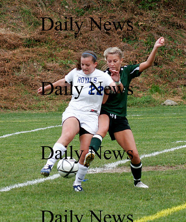 Georgetown: Georgetown's Kassandra Barba (22) battles for a ball with Pentucket's Breanna Yocum (3) as the Royals hosted the Sachems Tuesday afternoon. Photo by Ben Laing/Staff Photo