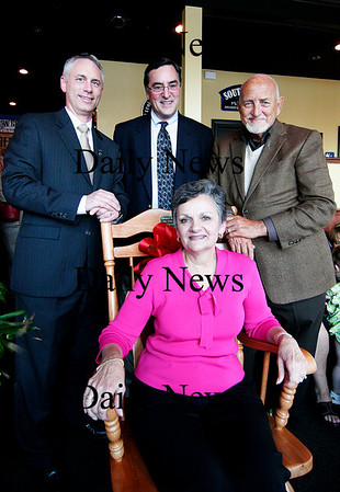 Amesbury: Longtime city hall employee Donna Motsis was honored Monday evening with a retierment party at the Ale House in Amesbury. She was joined with the three mayors of Amesbury, Nick Costello, right, David Hildt, center, and Thatcher Keezer, left. Photo by Ben Laing/Staff Photo
