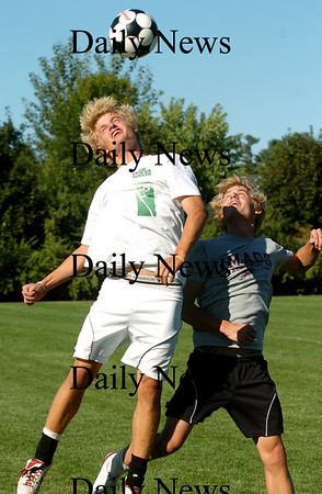 Newburyport: Senior captains and twin brothers, Steve Bajko, left, and Mark, right, fight for a header during practice Monday afternoon, as the Newburyport Clippers prepare for their next opponent. Photo by Ben Laing/Staff Photo