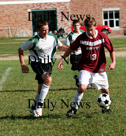 West Newbury: Clippers defender Jeff Jones (13) avoids pressure from a Pentucket player during Monday's game in West Newbury. The Sachems fell to visiting Newburyport 2-1. Photo by Ben Laing/Staff Photo