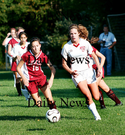 Newburyport: Sophmore Hannah Martin (6) blows past a Lowell defender as the Clippers faced thier guests at Cherry Hill. Photo by Ben Laing/Staff Photo