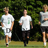 Newburyport: Twin brothers, Steve Bajko, left, and Mark, right, run sprints during Monday's practice. The pair are co-captains of the Newburyport soccer team, along with fellow senior Jeff Jones, center. Photo by Ben Laing/Staff Photo