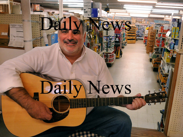 Amesbury: Not only does Tony Matrumalo own Easter Lumber and Hardware in Amesbury, he's a country songwriter and hosting a music series this month. Bryan Eaton/Staff Photo  Newburyport News  Thursday September 17, 2009.