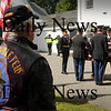 Newburyport: Newburyport and Mass. State Police, in background, salute as the body of Jordan Shay is taken into Twomey-LeBlanc Funeral Home yesterday morning. Bryan Eaton/Staff Photo Newburyport News Thursday  September 10, 2009.