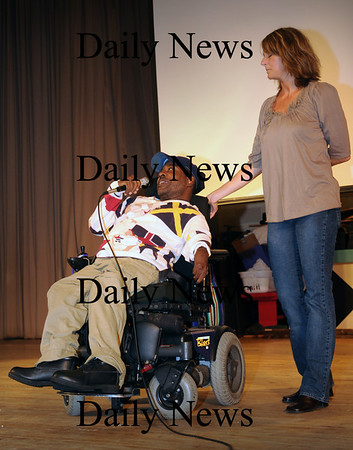 "Newburyport: Tony Knight, who was featured in the film "" Shooting Beauty"" speaks with Nock Middle School students with Courtney Bent, wife of director George Kachadorian, after they saw the film Friday morning. The film, about individuals who live at a center for people living with significant disabilities, will be shown in the weekend's Newburyport Film Festival. Bryan Eaton/Staff Photo"